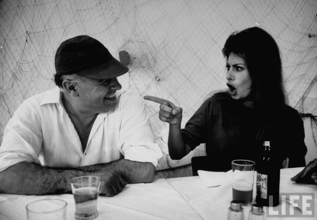 Actress Sophia Loren humorously berating her husband, movie producer Carlo Ponti, while dining in restaurant. Alfred Eisensteadt